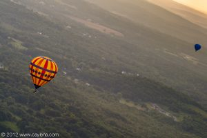 A balloon floats over Poughkeepsie this morning as part of the Dutchess County Balloon Festival. (July 7, 2012)