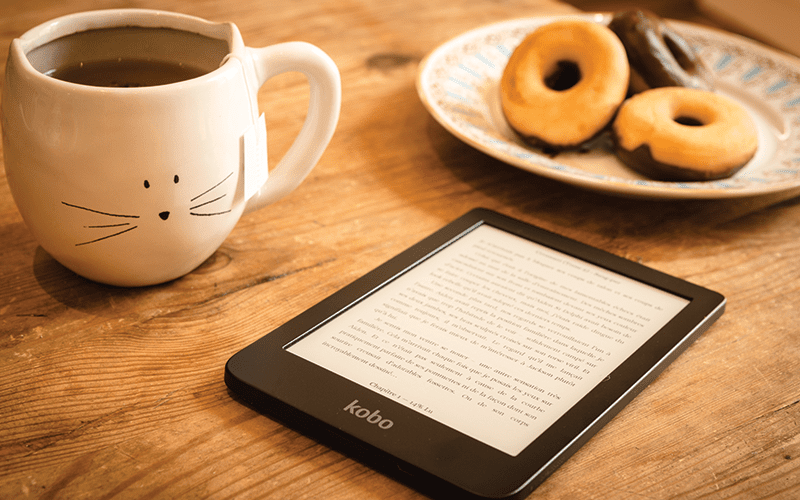 breakfast and reading tablet on table