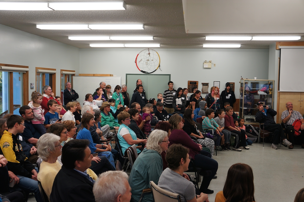 large group sitting in the Sandy Saulteaux Centre hall
