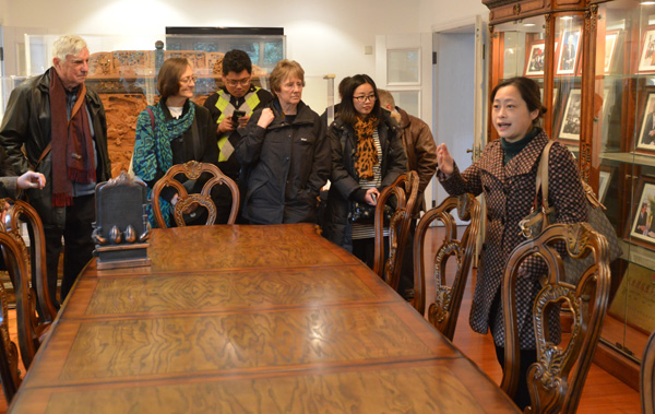 Maylanne (centre) with delegation at the Amity Printing Company (photo by Alan Lai)