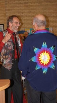 Grad Hubert Den Draak chatting with Companion of the Centre Stan McKay