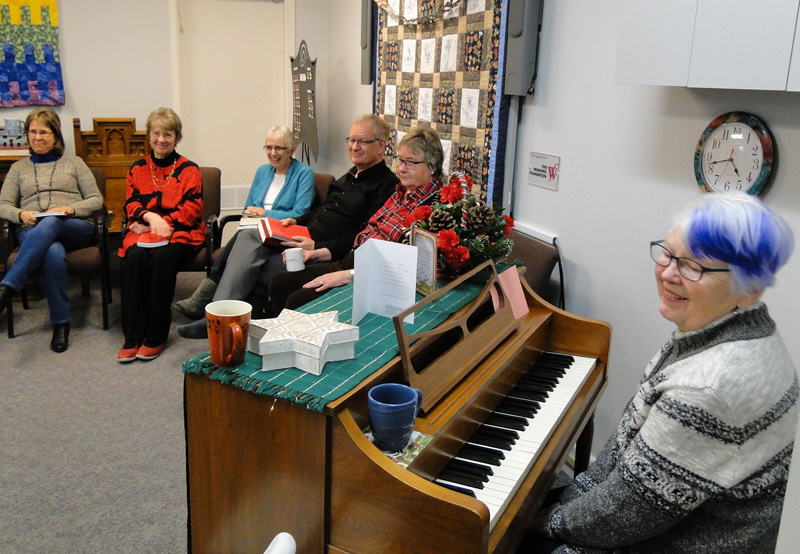 More cookie-eaters and carolers, with Heather Robbins on piano.