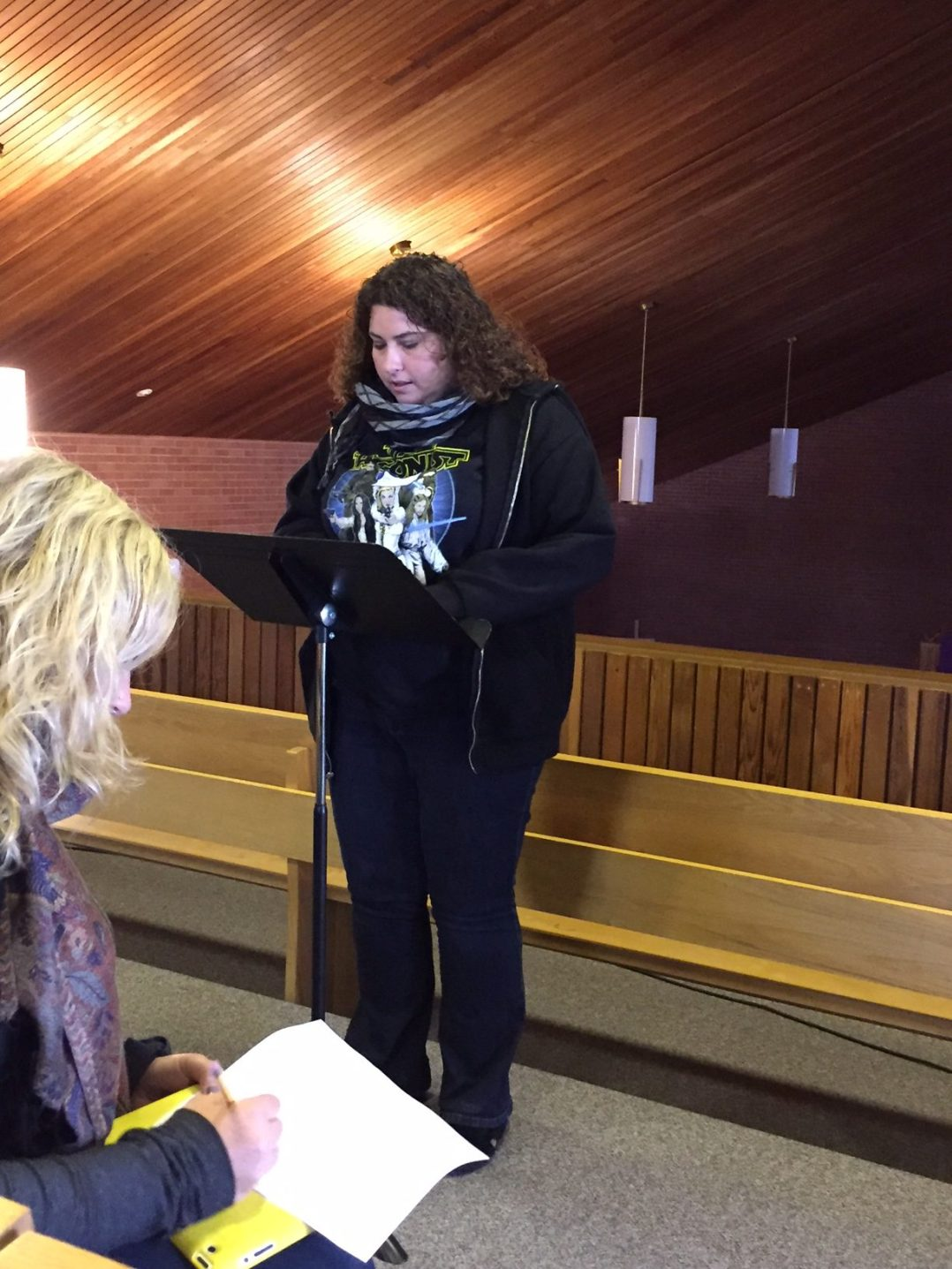 Rachel presenting her sermon in the choir loft
