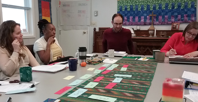 Sam, Marlene, David, and Lori put their cards on the table as they redesign the program.
