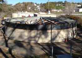 A water tank in Rancho Calaveras in the process of having a new roof installed.