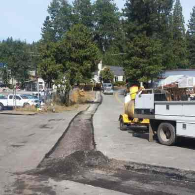 Crews work on paving a section of Dunbar Road.