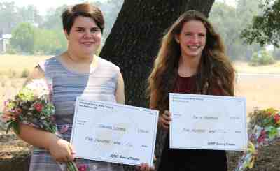CCWD 2018 scholarship award recipients, Claudia Loomis, left, and Sierra Stephens hold their awards after a CCWD Board meeting on August 8.