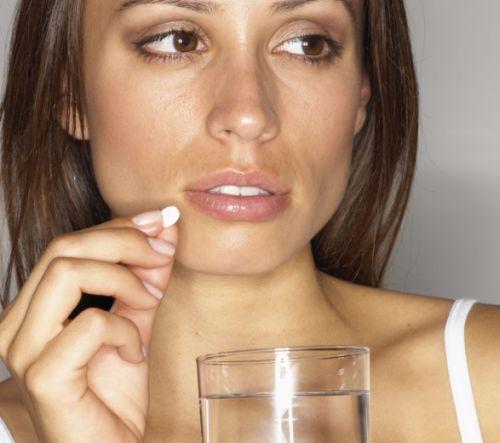 Woman taking an aspirin