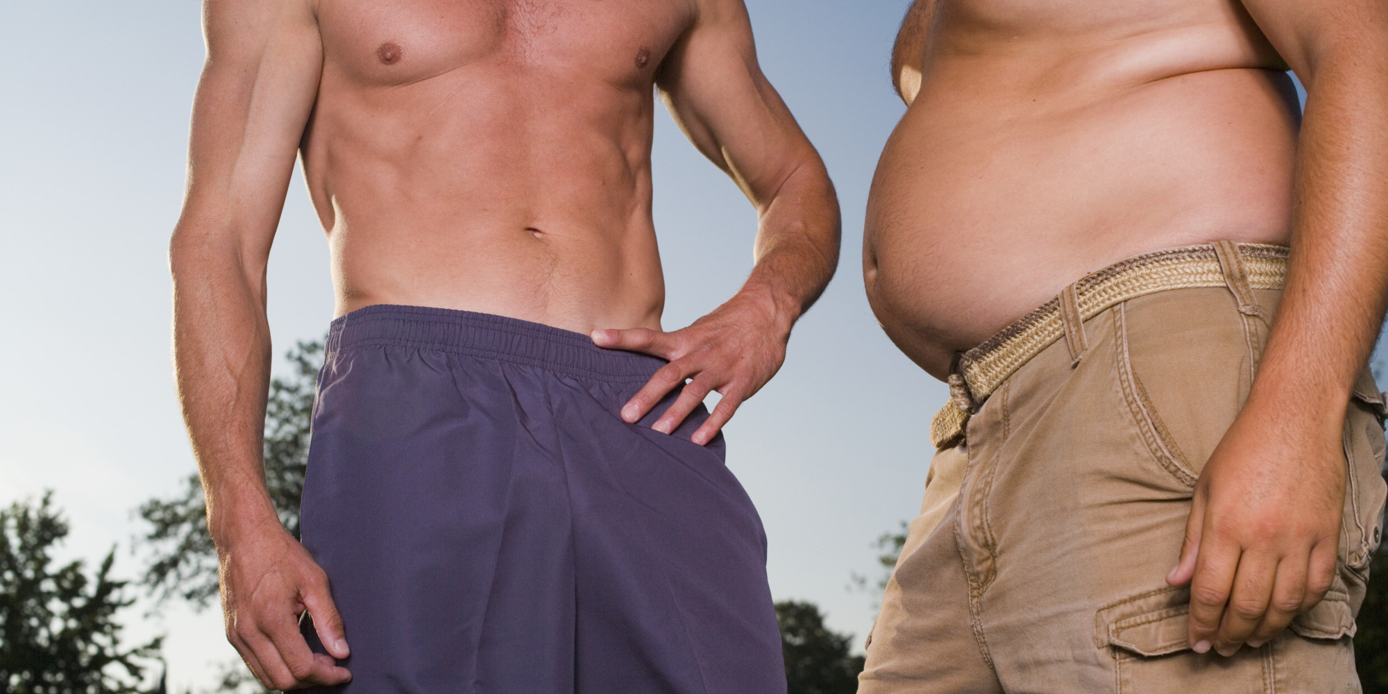 Torsos of fit man and overweight man, outdoors