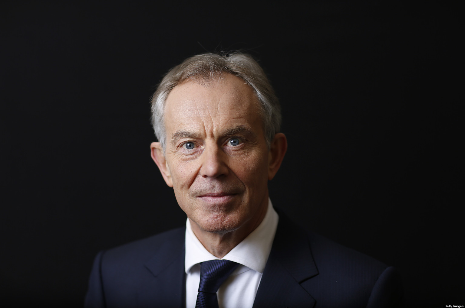 Tony Blair, former U.K. prime minister, poses for a photograph after a Bloomberg Television interview on the opening day of the World Economic Forum (WEF) in Davos, Switzerland, on Wednesday, Jan. 23, 2013. World leaders, Influential executives, bankers and policy makers attend the 43rd annual meeting of the World Economic Forum in Davos, the five day event runs from Jan. 23-27. Photographer: Simon Dawson/Bloomberg via Getty Images