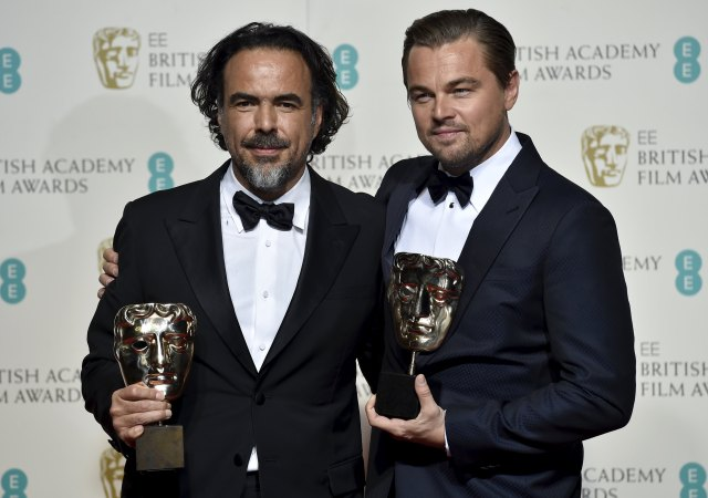 Best director Alejandro Inarritu and best leading actor Leonardo DiCaprio (R) hold their awards at the British Academy of Film and Television Arts (BAFTA) Awards at the Royal Opera House in London, February 14, 2016. REUTERS/Toby Melville