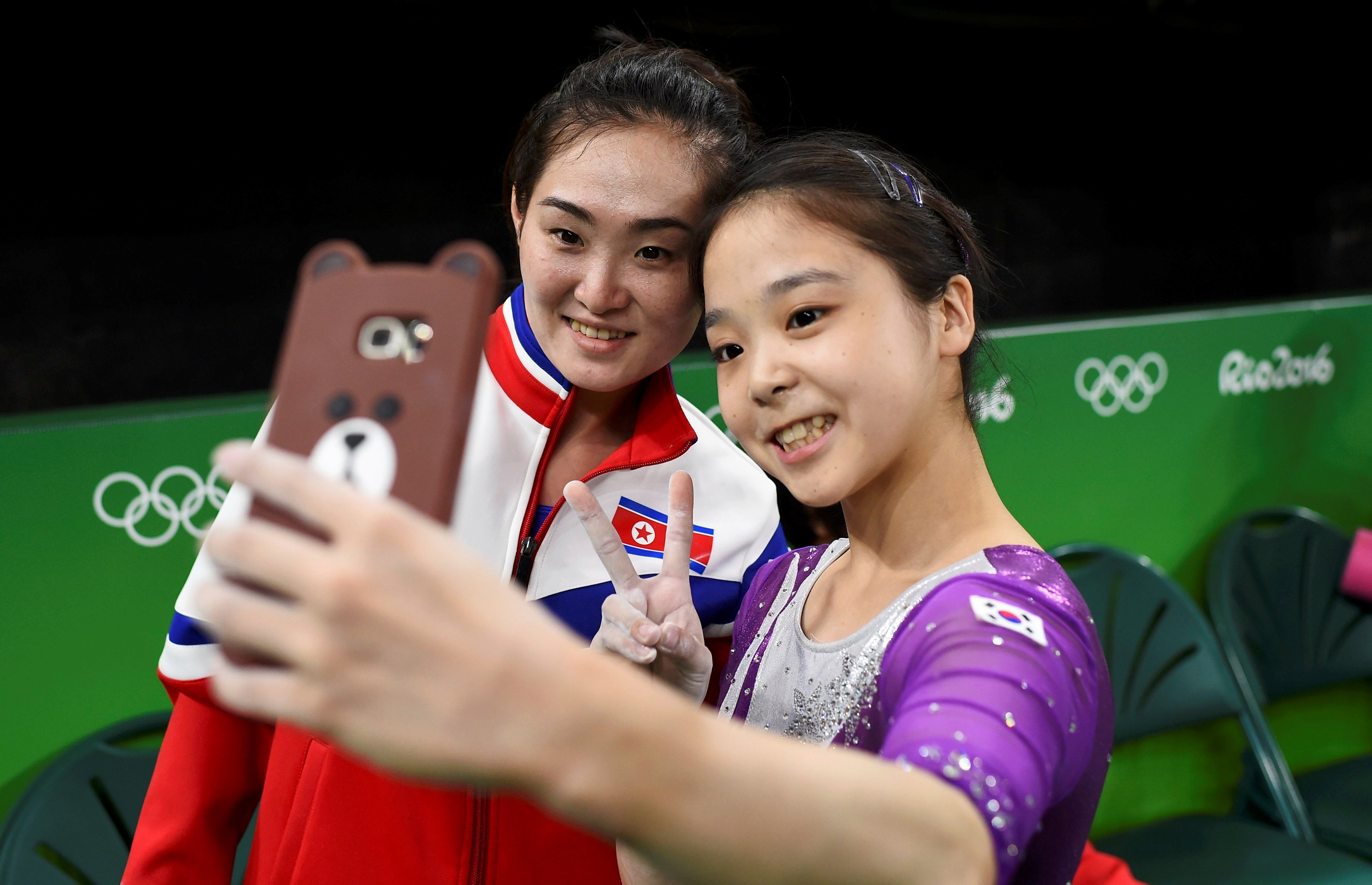 REFILE - CORRECTING ID OF SOUTH KOREAN ATHLETE 2016 Rio Olympics - Gymnastics training - Rio Olympic Arena - Rio de Janeiro, Brazil - 04/08/2016. Lee Eun-Ju (KOR) of South Korea (R) takes a selfie picture with Hong Un Jong (PRK) of North Korea. REUTERS/Dylan Martinez TPX IMAGES OF THE DAY. FOR EDITORIAL USE ONLY. NOT FOR SALE FOR MARKETING OR ADVERTISING CAMPAIGNS.