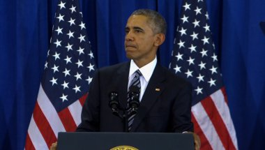 Obama vows action against Russia for hacks