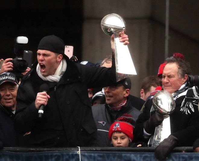 New England Patriots quarterback Tom Brady, New England Patriots head coach Bill Belichick, hoist the Lombardi Championship trophiesduring Super Bowl LI victory parade in Boston