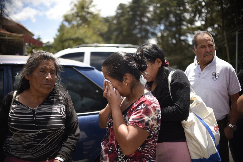 Relatives cry outside the children