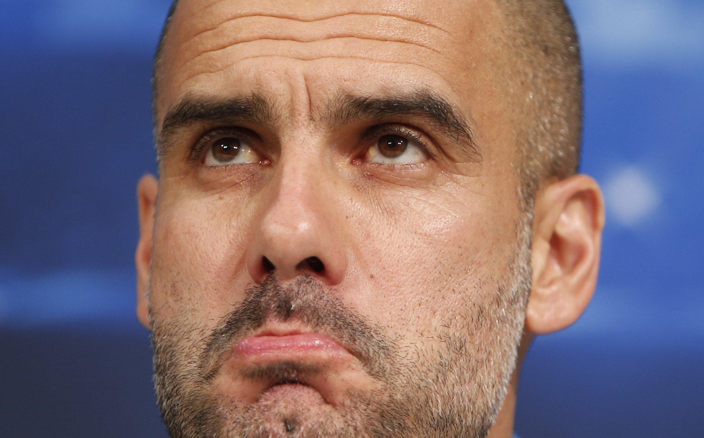 Bayern Munich head coach Guardiola addresses a news conference in Munich
