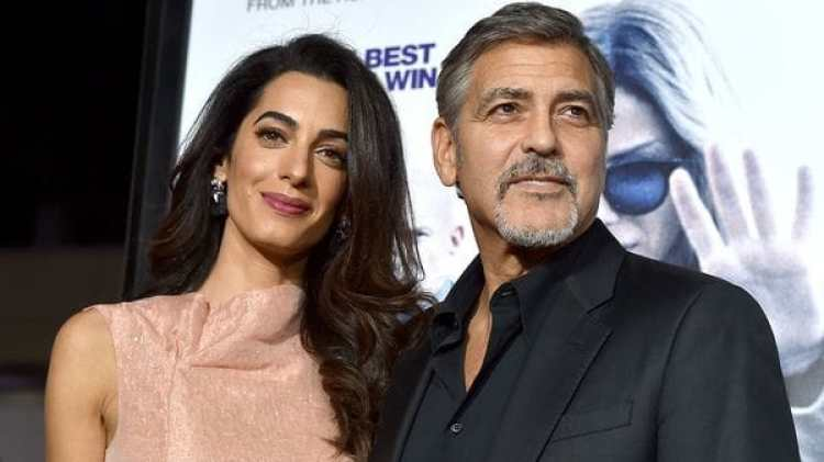 """HOLLYWOOD, CA – OCTOBER 26: Amal Alamuddin (L) and actor George Clooney attend the premiere of Warner Bros. Pictures' """"Our Brand Is Crisis"""" at TCL Chinese Theatre on October 26, 2015 in Hollywood, California. (Photo by Kevin Winter/Getty Images)"""
