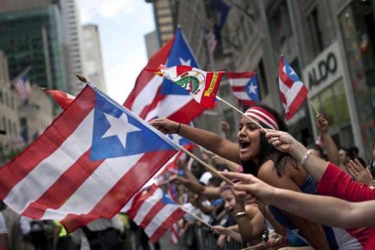 Además de tener pasaporte estadounidense, los boricuas tienen familias en grandes comunidades del país, como es el caso de la de Nueva York. (Getty Images)