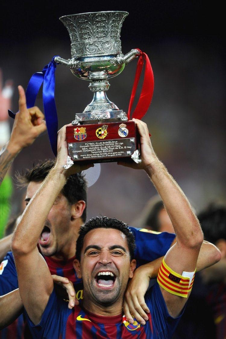 2011: Xavi, capitán de otra temporada soñada del Barcelona ganando la Champions, la Liga, la Supercopa de Europa y el Mundial de Clubes entre otros títulos(Getty)