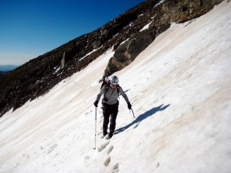 Traversing a long snowfield to get into the cirque.
