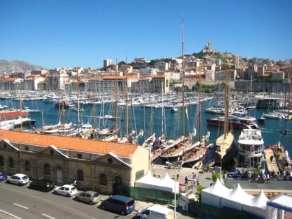Bienvenue a Marseille. Notre Dame de la Garde dominates the view from the Vieux Port.