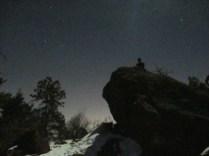 Jason lurks, vulture-like, on the summit boulder.