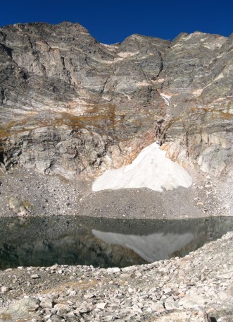 Upper Spectacle Lake and the remnant snow on the Y-Couloir route.