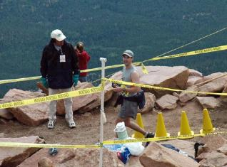 Peter reaches the summit and turn-around point in the Marathon.