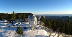 The three smaller telescopes at APO from the catwalk on the 3.5 meter.