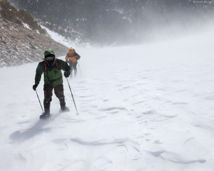 Eric and I struggle up the glacier in the teeth of the gale (photo by Scott)