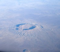First thing in the morning, I looked out my window and saw this. Turns out, this is Brukkaros Volcano in Namibia.