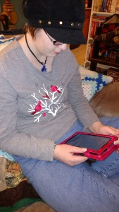 Shelby with her Kindle Fire, Games