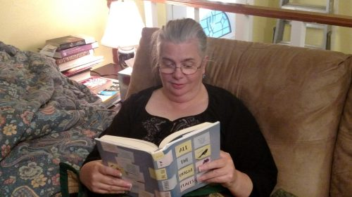 Laura Reading for Book Club, About Us