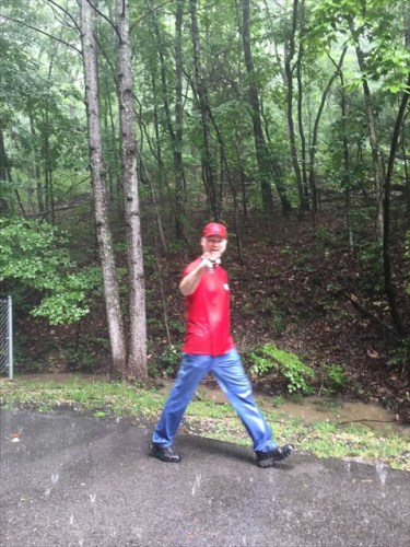 geocacher walking in the rain