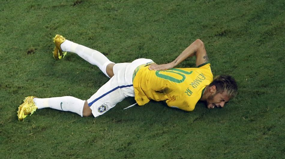 Brazil's Neymar lies injured during the World Cup quarterfinal against Colombia