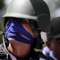 epa07538422 Members of the Bolivarian Armed Forces, supporters of Venezuelan National Assembly President Juan Guiado, attend a protest in Caracas, Venezuela, 30 April 2019. Venezuelan interim President Juan Guaido has asked supporters to take to the streets in order to end the regime of President Nicolas Maduro. Meanwhile, Venezuelan opposition leader Leopoldo Lopez was freed from his house arrest, appearing alongside Guaido and military forces in Caracas. EPA-EFE/Miguel Gutierrez