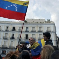 epa07538515 Secretary General of Venezuelan political party 'Causa Radical' in Spain, Manuel Rodriguez (C), delivers a speech during a gathering of Venezuelan nationals in Sol Square in Madrid, Spain, 30 April 2019. Venezuelan interim President Juan Guaido has asked supporters to take to the streets in order to end the regime of President Nicolas Maduro. Meanwhile, Venezuelan opposition leader Leopoldo Lopez was freed from his house arrest, appearing alongside Guaido and military forces in Caracas. EPA-EFE/EDUARDO OYANA