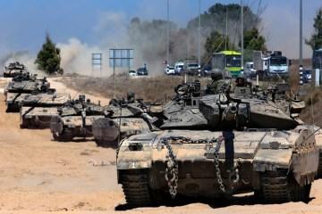 UPDATED: Israeli troops mass at Gaza border, hundreds of rockets hit Israel, its jets strike Gaza