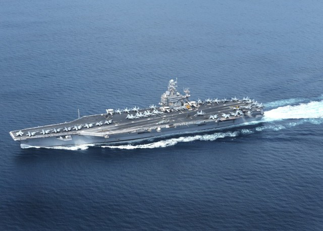 The US deploys carrier strike group to Middle East as 'warning' to Iran