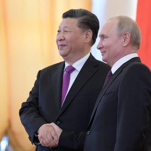 Putin and Xi meet to strengthen ties