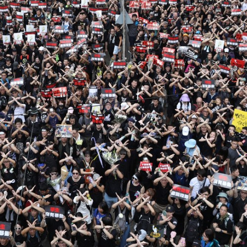 Huge turnout for 'black rally' in Hong Kong to demand resignation of the territory's leader