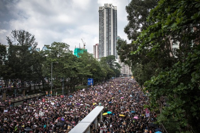 Protesters march to call for a complete withdrawal of the extradition bill.