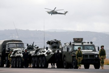 Russia says it has begun pulling out troops from Crimea after drills