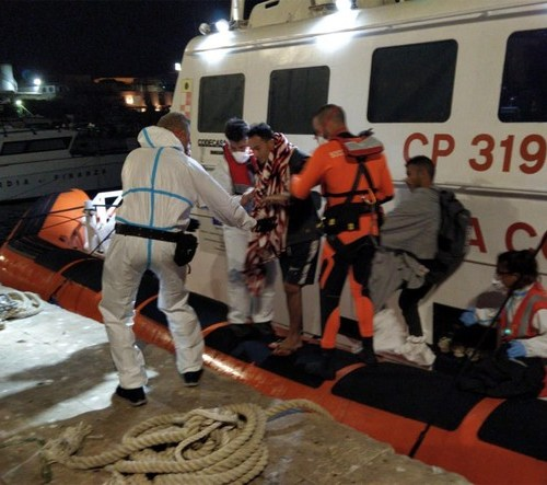 Four people disembark from the Open Arms in Lampedusa