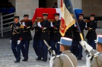 French Republican guards carry the flag-draped coffin of late French President Jacques Chirac during a military funeral honors ceremony at the Hotel des Invalides during a national day of mourning in Paris, France, 30 September 2019. EPA-EFE/PHILIPPE WOJAZER