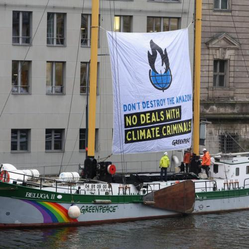 Greenpeace activists protest in Berlin against Brazil government