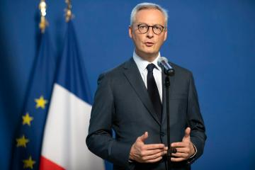 """France expects minimum tax to yield """"several billion"""" euros"""