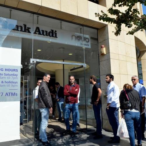 Lebanese banks reopen for first time in two weeks