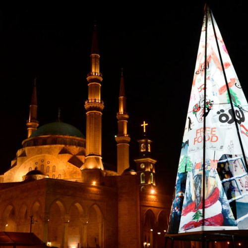 Photo Story: A Christmas tree made of protest banners in Beirut