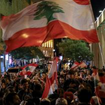 epa08055857 Protesters carry placards and wave Lebanese flags as they shout slogans against the parlianment members, during an anti-government protest in front of the Parliament building in Beirut, Lebanon, 08 December 2019. Protests in Lebanon are continuing since it first erupted on 17 October, as protesters aim to apply pressure on the country's political leaders to over what they view as a lack of progress following the prime minister's resignation on 29 October, demand to speed up the process to appointment of a new prime minister, without the corrupt political class. Lebanese President Michel Aoun called for formal consultations on 09 December with lawmakers to designate a new prime minister, but it was canceled after the candidate Samir Khatib announced his withdrawal from the candidacy, after his visit Dar Al Fatwa, as said to media that, the country's top Sunni religious authority told him the community supports resigned prime minister Saad Hariri to take back the post. EPA-EFE/NABIL MOUNZER